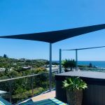 Triangle shade sail on rooftop apartment